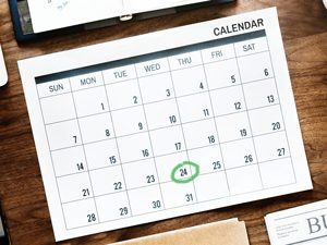 A calendar with green date circled.
