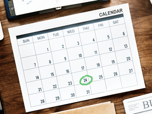 A calendar with the green date circled