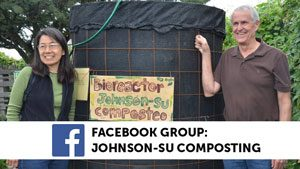 David Johnson Su compost Facebook Group. David and Hui-Chun standing with a compost bioreactor.