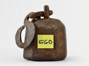 The word ego written on a weight