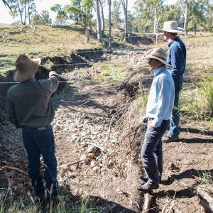 RCS team and grazier considering how to manage erosion