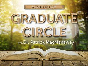 Quantum Leap Graduate Circle. Book lying open on deck with trees and sunflare in the background